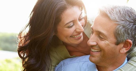 closeup-smiling-couple-40s_573x300